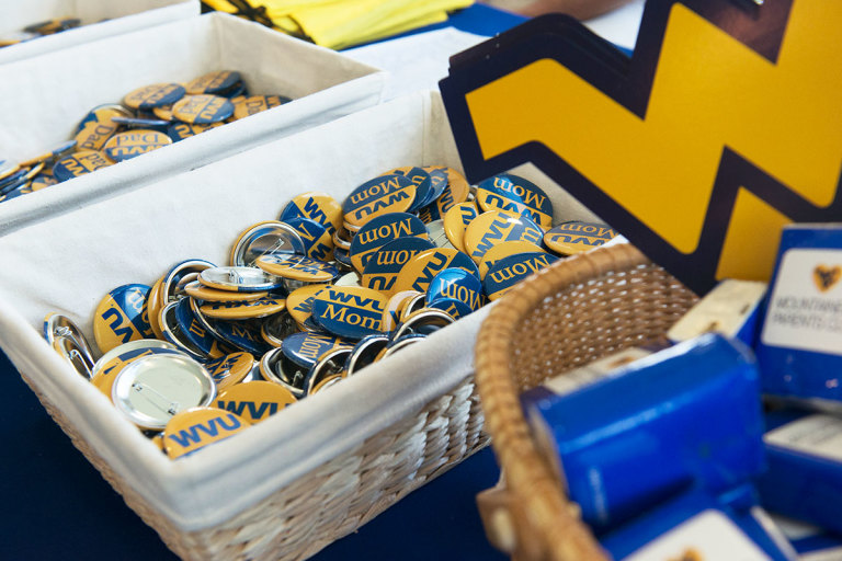 WVU Mom and WVU Dad buttons in baskets