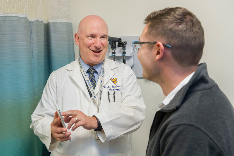 WVU Medicine urologist Stanley Zaslau talks with a patient
