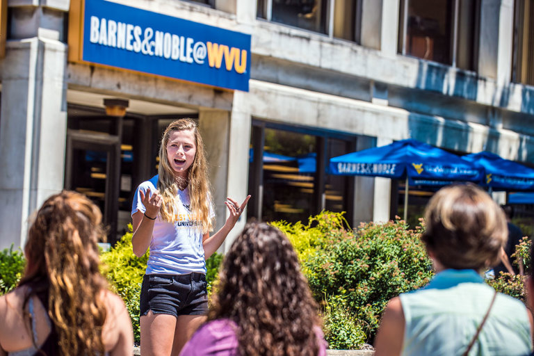 Tour guide speaks to group in front of Barnes & Noble WVU Bookstore.