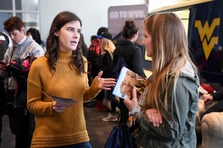 A prospective student talks with a Reed College of Media representative