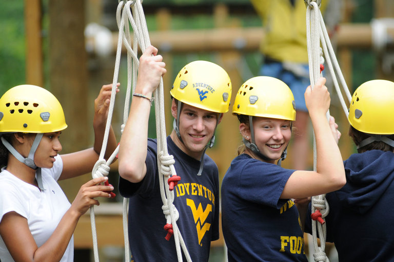 Adventure WV students take a break from climbing at the WVU Challenge Course