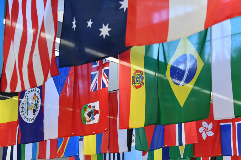 Flags from many different countries hang from the ceiling of the Mountainlair Student Union