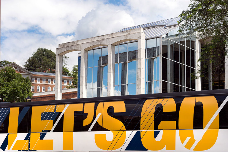 Let's Go banner on side of WVU bus