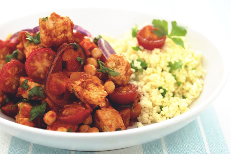 Moroccan tagine recipe made with Quorn Pieces, chickpeas and tomatoes served with couscous in a white dish