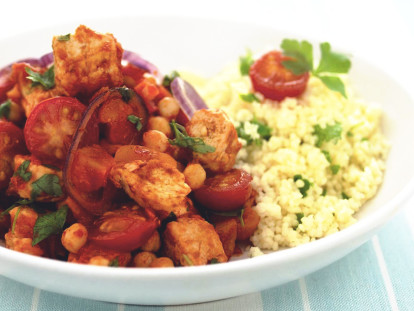 Moroccan Tagine made with Quorn Meatless Pieces, chickpeas and tomatoes served with couscous in a white dish