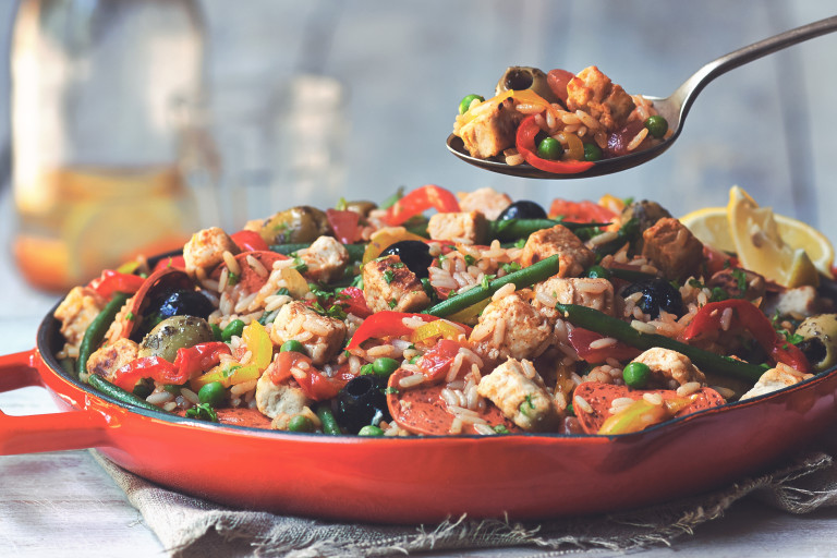 Vegetarian paella recipe made with Quorn Vegan Pieces, Quorn Vegan Pepperoni Slices and vegetables served in a red pan