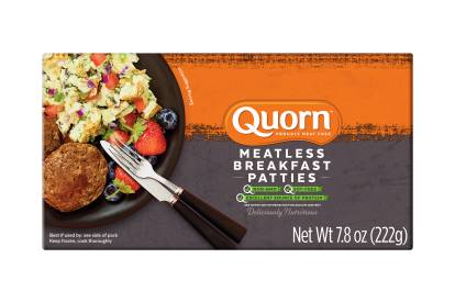 A box of Quorn Meatless Breakfast Patties showing the product and its name on an orange and charcoal background.