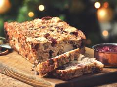 Meatless nut loaf made with Quorn pieces, chestnuts and cranberries next to a pot of sauce