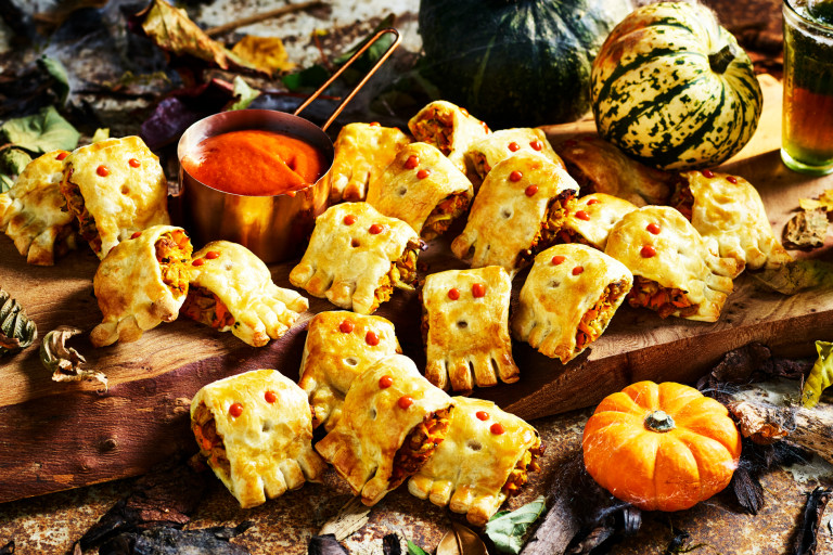 Mini sausage rolls filled with Quorn Cocktail Sausages decorated to look like little ghosts with a tomato dip.