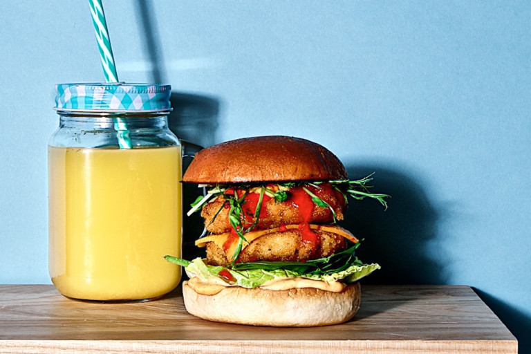 Two Quorn Southern Fried Burgers in a burger bun with salad and sriracha mayo