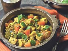A bowl of Keralan curry made Quorn pieces, vegetables and coconut milk.