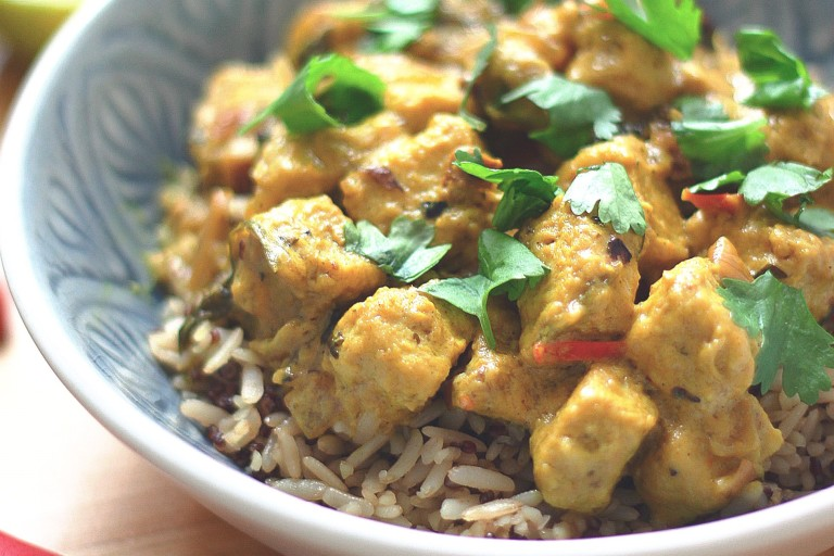 Meat-free curry made Quorn pieces in a lime and coconut sauce served on a bowl of rice garnished with chopped coriander
