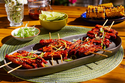 platter with four servings of Korean BBQ Skewers made with Quorn Vegan Meatless Fillets topped with sesame and scallions.