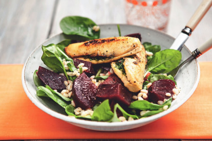 A spinach and bulgur wheat salad topped with beets and Quorn Fillets stuffed with herbs.