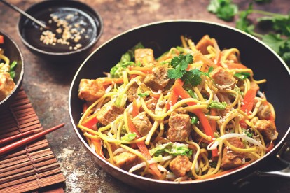 Vegetarian chow mein noodle dish with Quorn Pieces, carrot and beansprouts, served in a wok