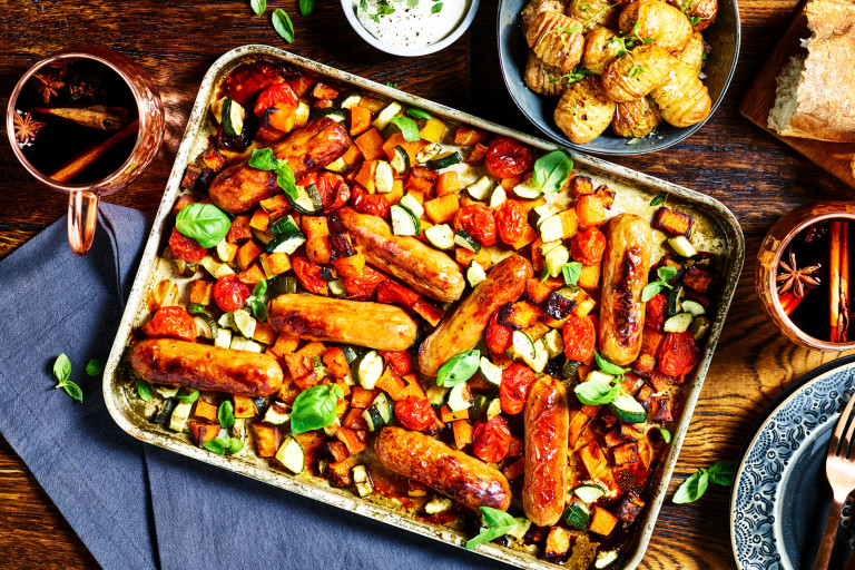 A traybake with Quorn Best of British Sausages, butternut squash, tomatoes, and courgette.