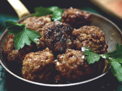 A dish of seven meatballs made with Quorn Mince and garnished with parsley.