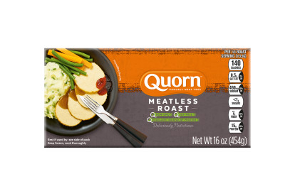 A box of Quorn Meatless Roast showing the product and the product information on an orange and charcoal background.