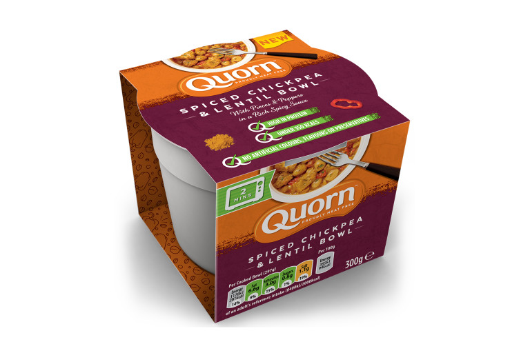 A Quorn Spiced Chickpea and Lentil Bowl in its packaging showing the prepared product and information on an orange and maroon background.