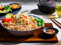 Veggie Pad Thai recipe made with Quorn Pieces and noodles served in a bowl, garnished with chilli and coriander