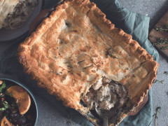 A pot pie in the baking dish with a portion removed to reveal a filling of Quorn Fillets, brie, fennel, and mushrooms.