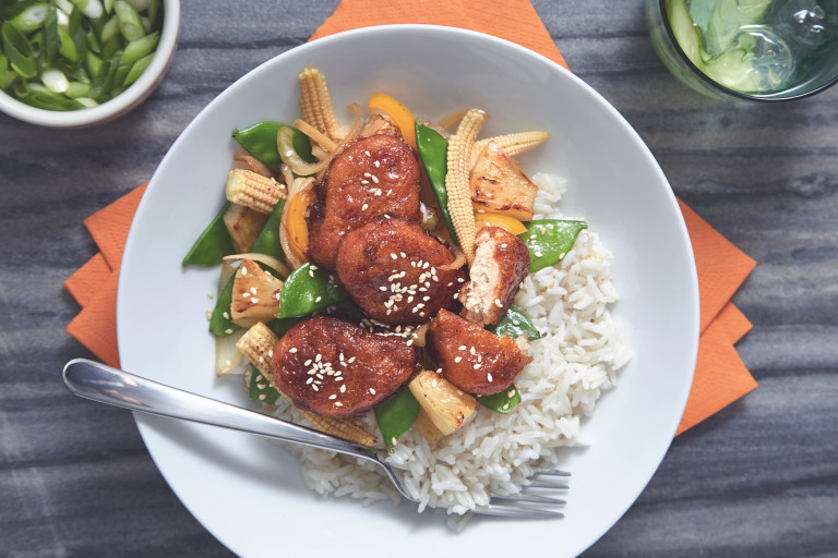 A bowl of Sticky Sweet & Sour Quorn Nuggets served on top of warm rice.
