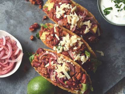 Vegetarian chipotle tacos made with Quorn mince accompanied with pickled onion and sour cream