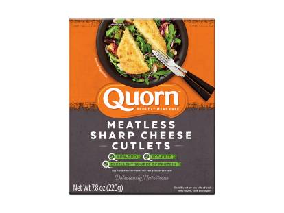 A box of Quorn Meatless Sharp Cheese Cutlets showing the product and product information on an orange and charcoal background.