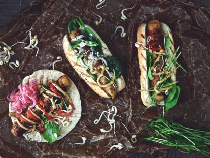 Quorn Bratwurst hot dog with pickled red onions