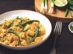 A bowl of Laksa made with Quorn pieces, chilli and ginger, and served with rice noodles.