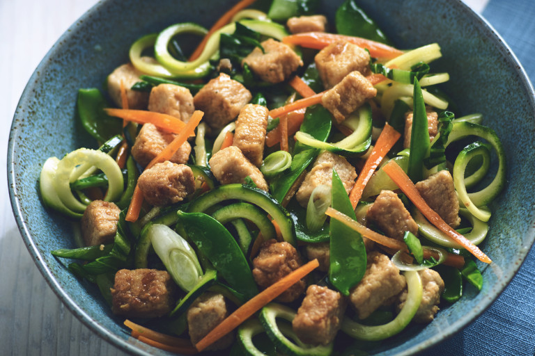 Vegetarian stir fry with Quorn Meatless pieces and zuccini noodles served in a bowl