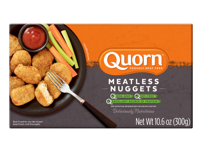 A box of Quorn Meatless Nuggets showing the plates product and information on an orange and charcoal background.