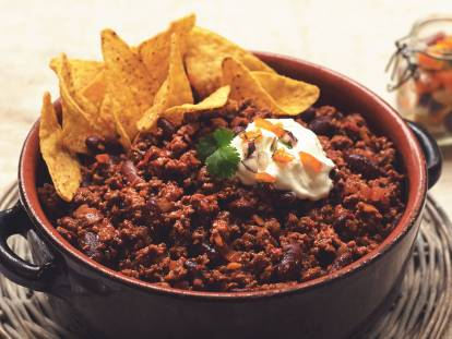 Vegetarian Quorn Chilli con Carne served in a casserole dish topped with nachos