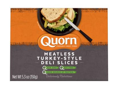 A box of Quorn Meatless Turkey Style Deli Slices showing the product and product information on an orange and charcoal background.