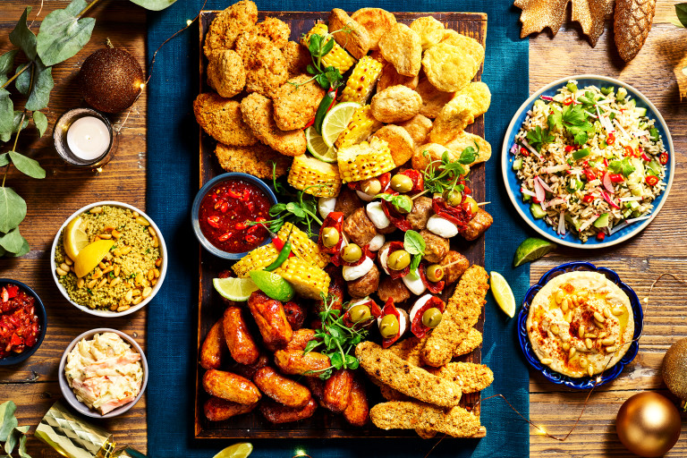 A festive platter topped with Quorn Cocktail Sausages, Quorn Crispy Nuggets, Quorn Southern Fried Bites, Quorn Sweet Chipotle Goujons, Quorn Swedish Style Balls, mozzarella skewers, corn, and dips.