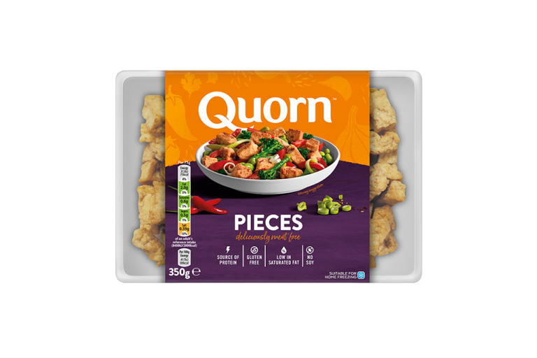 A bag of Quorn Pieces showing the prepared product and information on an orange and charcoal background.