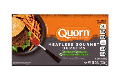 A box of Quorn Meatless Gourmet Burgers showing the product and the product information on an orange and charcoal background.