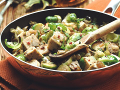 Quorn Roast, Brussels sprouts, leeks, and onion in a pan.