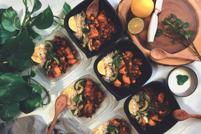 Vegetarian Curry Hot Pot, made with Quorn Mince, sweet potatoes, chickpeas, spinach, lime, beans and onion, served in bowls.
