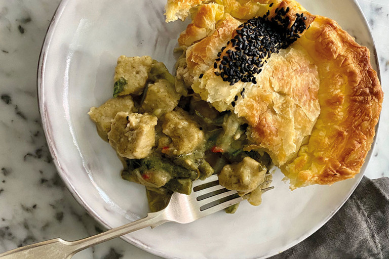 A generous serving of a puff pastry pie filled with Quorn Vegan Pieces and vegetables in a Thai green curry sauce.