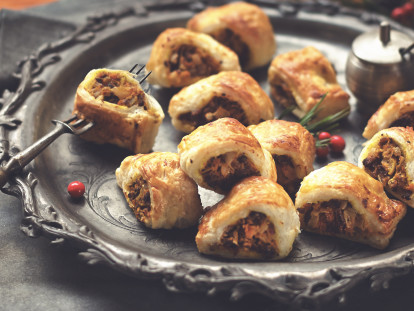 A serving plate with butternut squash sausage rolls with Quorn mince.