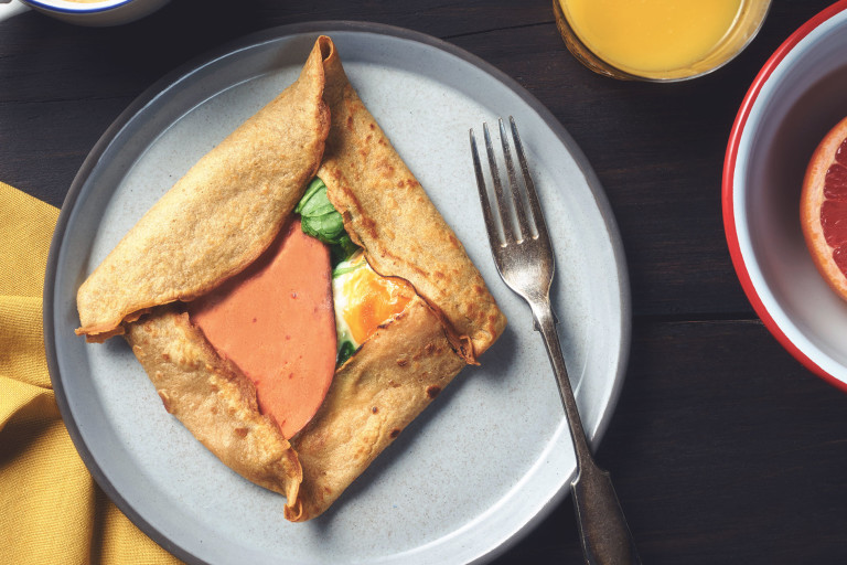 A buckwheat pancake filled with Quorn Vegetarian Bacon, cheese, and eggs.