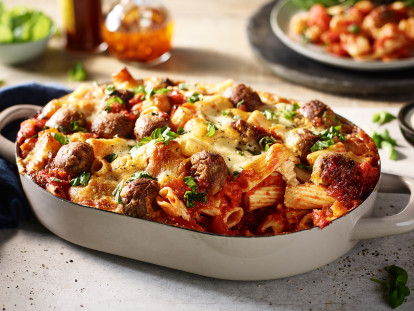 A pasta bake with a tomato sauce and Quorn Swedish Style Meatballs topped with cheese and coriander.