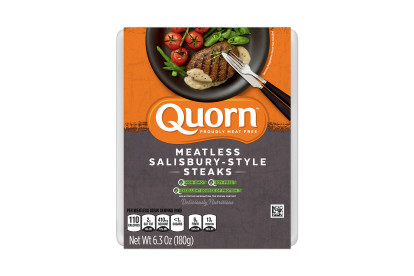 A package of Quorn Meatless Salisbury-Style Steaks showing the plated product and information on an orange and charcoal background.