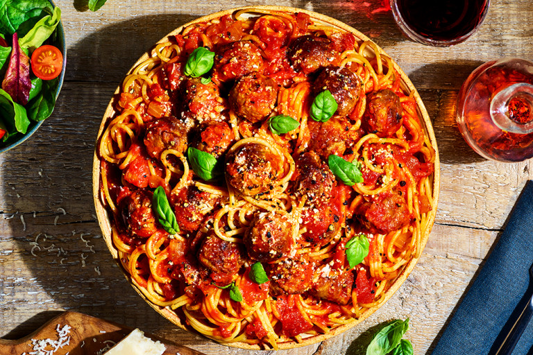 A bowl of vegetarian spaghetti and Quorn Swedish Style Balls in a tomato sauce.