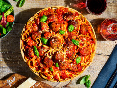 A bowl of vegetarian spaghetti and Quorn Swedish Style Meatballs in a tomato sauce.