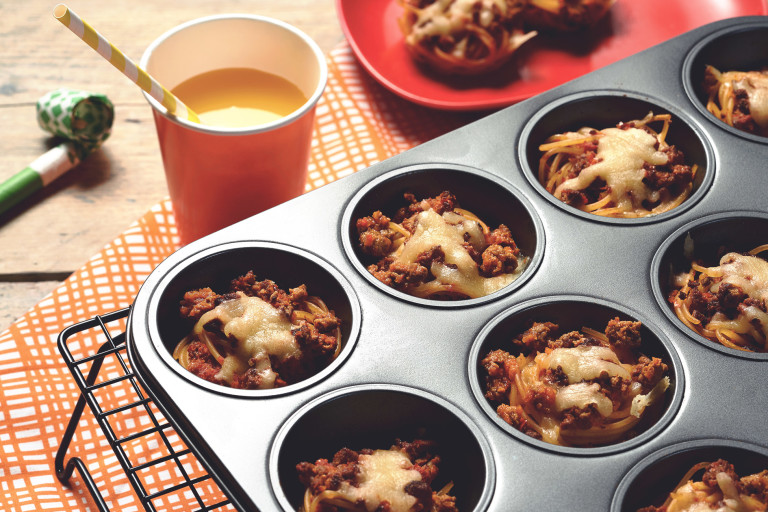 Easy meals for kids made with Quorn Mince on individual beds of spaghetti served in a muffin pan on top of a cooling rack