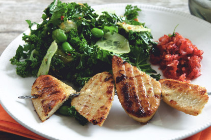 Grilled Quorn Fillets served with a kale and edamame salad with cucumber slices on top and a pico de gallo salsa on the side.