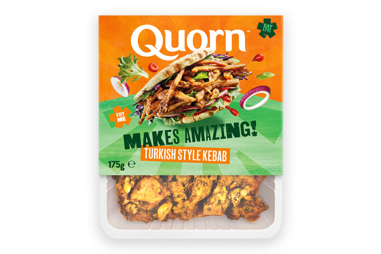 A packet of Quorn Makes Amazing Turkish Style Kebab with the product visible in the bottom third below an orange and light green label showing the prepared product and information.