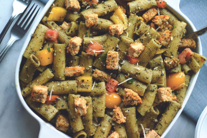 A vegan pesto pasta salad topped with diced Quorn Spicy Vegan Pieces.